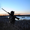 "Tim Romano of Boulder savors the sunrise as he prepares for a morning duck hunt near Jackson Lake State Park last week. The waterfowl action has been steady with mallards and Canada geese migrating through Colorado's ""Golden Triangle"" in late November.<br /> Scott Willoughby, The Denver Post"