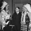 John Collier with tribal regalia  Dewey Beard, left, and James Pipe-on-Head,