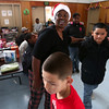 Arquilla Conner executive director of Men of Purpose gives toys
