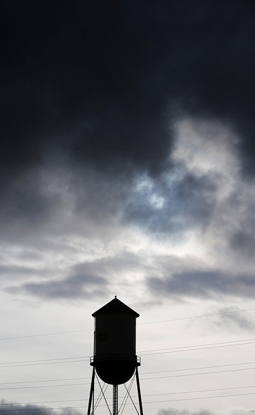 The old Del Monte water tower is silhouetted by storm clouds in San Jose, Calif., on Sunday, Feb. 9, 2014. While the sky was full of rain clouds, very little rain made it to the ground during the day. (Jim Gensheimer/Bay Area News Group)