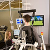 Melissa W Banta, DPT, physical therapist and manager of inpatient rehab at Sheltering Arms' Hanover physical rehabilitation center, talks with a patient using the Lokomat Pro, a robotic walk re-trainer