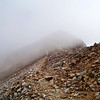 A storm cloud covers the trail at 14,000 ft. along the southwest ridge of Mt. Lincoln.