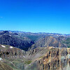 Hikers are treated to a spectacular vista of the San Juans as they traverse between Redcloud and Sunshine Peaks, Colorado.