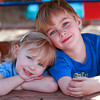 siblings sitting close on bench