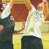 unbc b-ball brent sevigny in thursday dave milne' jan 5 00 brent sevigny, right, does a layup during practice at CNC