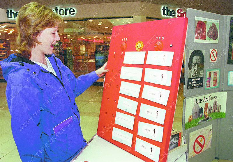 Weed-Free1/Thursday Brent Braaten-Jan 19/2000  Terri Reynolds takes a tabacco facts quiz at the Weed Free Wednesday display at centre court in Pine Centre mall.  Weed Free Wednesday is part of National non smoking week. The Northern Interior Health Unit along with the Canadian Cancer Society had displays.