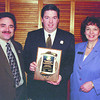 Chamber-Citizen/Thursday Brent Braaten-Feb 16/2000  Lorne Calder, left President of the Chamber of Commeace and Sherry Sethen, right Executive Director with the Chamber present John Harding editor of the Prince George Citizen with a plaque honoring the membership of The Citizen in the Chamber for 85 years.