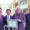 UNBC gets mitsui home donation in   thursday dave milne april 5 00 With a backdrop of the UNBC administration building atrium, UNBC president Dr.Charles Jago, second from right, presents Mitsui Home Canada Inc executives with a framed certificate of appreciation for $80,000 in donations received by UNBC from the company to date.  The most recent donation was $20,000.Posing with Dr. Jago from the left are: Yasuo Takeshima, general manager, Michihiko Takada, executive vice-president and on the far right, Ron Neil, senior vice-president.