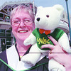 UNBC Grad Helen Domshy/Saturday Brent Braaten-May 25/2001  Helen Domshy graduating from UNBC with Master of Arts Gender Studies with her UNBC mascott. She was one of 650 grads today.