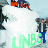 Snow Sculture/Monday Brent Braaten-Feb 10/2002  UNBC team members involved in the Great Snow and Ice Challenge Event pose with their snow sculpture Saturday afternoon infront of the court house.  The challange was between UNBC and CNCwith each doing one sculpture part of Snow Daze 2002. On top Tania Bopp and Bruce Muir beside Nathan Frost.