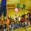 nechako school egg drop in friday dave milne march 28 02 North Nechako Elementary School student council menber Cavan Sweet drops an egg contained in a contraption designed by one of the sudents to prevent the egg from breaking. Each of the students in the school was challenged to engineer a container which would prevent an egg from breaking when dropped from a great height. Many of the eggs didn't break and ther names of these successful students were placed in a hat for a draw later.