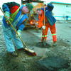 Pothole Patroll2/Wednesday Brent Braaten-April 2/2002  Len Massicotte, left, and James West with the City of Prince George streets Divison patch potholes with cold mix on 15th Avenue Tuesday evening. The frezze thaw  cycle has been creating a lot of potholes this spring.