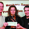 northen raptor donation in saturday dave milne june 7 02 BC Hydro manager of community relations david Conway, left presents Rachel Morey and Chad Bohanan from the Northern Raptor Preservation Society with a cheque for $500 from the Hydro Regional Donations Program.