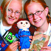 girl guide travelling doll in thursday dave milne june 26 02 Girl Gudes Leandra Hooker-Armstrong, 9, left from the 1st South Fort Girl Guides and Kelsey Ball, 9, from the Kelly Rod Girl Guides hold doll Guilda Guide, a diary and a disposable camea, all of which will soon be heading around the world. BERNICE STORY