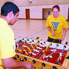 Youth Drop-In2/Thursday Brent Braaten-July 10/2002  Onkar Buttar and Lisa Baylis play some  fusball? at the YMCA youth drop in centre located in the gym at Kinsman Place. The YMCA with sponcorship from Liesure Services runs youth drop in centres at Kinsman Place and at the Hart Community Centre. The centre at Kinsman Place is open between 1-5 6-10 Monday through Thursday and the Hart location is opern 1-4:30 6-11 Monday through Thursday day. It is open for youth between ages 12-18. There are lots of activites from Nentindo to basketball.