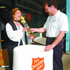 Friendship Day Salvation Army2/Friday Brent Braaten-Aug 22/2002  Carol Harrison brought her donation of can goods to Growers Direct and received her 6 roses from Wayne Kehl representing the United Way. This was the 6th year that Grower Direct Flowers celbrated Friendship day with a collection for the Salvation Army.The goal this year was to fill a huge truck with over 3,000 pounds of food for the Salvation Army.