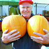 Ed Marleau at the Pleasant Valley Fruit Stand at 1st Ave. and Queensway shows off some colorful fall pumpkins. Fruit season isn't finished yet. There are more Fuji, Golden, Red, and Ambrosia apples to come. Pumpkins, Wednesday, David Mah