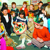 school native culture taught in thursday dave milne oct 23 02 Rose Thomas watches with  Spruceland Elementary School students in  Mrs. Thomson's  Grade 2 class as Angel Wesley, 8, beats a native drum. Rose is a Carrier teacher was at the school teaching the carrier language, customs and traditions.