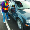 Lock it or lose It/Monday Brent Braaten-Nov 30/2002  Marilyn McCarron, Lock it or Lose It program coordinator  checks out a car in theWal-Mart  parkiung lot Saturday morning. The volunteers checked every car in the lot Saturday as part of the Lock it or Lose it campaign.They left ticket-like slips on windshields identifying security weaknesses such as possesions, shopping parcels and no immoblilizer or alarm. ICBC sponsors the program through their 'Auto Crime Prevention Grant'.