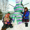 Colorfull Snowman/Monday Brent Braaten-March 2/2003  Dave Wiseman sits with his daughter Cassidy,3, and Charmayne Price, 5, next to the snowman he made and painted Sunday afternoon. Wiseman said it took him about a hour to make the snowman including painting it. The painting took most of the time.