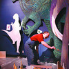 dinosaur painter in monday dave milne march 16 03 Luke Ho from Calgary paints life-size dinosaur cut-outs at The Exploration  Place during the Weekend. He and partner Barry Xu paint murals for museums and parks in BC and Alberta proving dinosaur painters are not dying out.