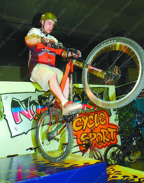 Bike rider/Home Show/Tuesday Brent Braaten-April 26/2003  Adam Spensley shows off his trials bike riding skills at the Northern Cycle and Sport Norco display.