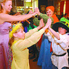 Highglen Cinderella Ball/Saturday Brent Braaten-May 23/2003  Destiny Boyarski and Bryce Faulder get a dance lesson from Pamala Haddock and her mom teacher Janice Haddock.  Two of the grade 4/5 classes had a Cinderella Ball  to end their 6 week study of fairy tales. Each of the students dressed up as a feiry tale charcter and they enjoyed lunch and a dance.