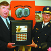 Fire Fighter Stamp/Saturday Brent Braaten-May 30/2003  Don McCarron local bussiness manager with Canada Post presents Chief Bryant Kemble representing all volunteer departments in the northern area. The new stamp is Canada post's tribute to firefighters.