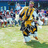 Native Dance Japan/Friday Brent Braaten-July 31/2003  Dustin Hogan a grass dancer with the Rainbow Dancers preforms for a group of Japanise Exchange Students infront of the Native Frienship Centre Thursday afternoon. The dancers preformed a varity of dances. The Japanese stuedents will be heading back to Japan on Monday concluding their two week visit.