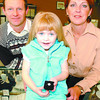 65 Roses Diamond Advance/Monday Brent Braaten-Nov1/2003  Courtney Riedel, 3, holds the diamond dinner ring valued at over $900 donated by Gemini Jewellers that will be the grand prize at this years 65 Roses dinner. Left Rocky Cooke Gemini Jewellers and Terry Riedel with the Cystic Fibrosis Foundation and organizer of the 65 Roses Dinner.