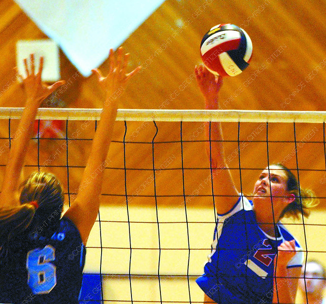 v-ball women cnc capillano2 in saturday dave milne jan 23 04 Courtney Almgren drives shot at Capillano Juliana Romza