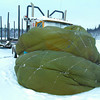 parachute truck cozy in tuesday dave milne jan 26 04 The hood and engine compartment of a log truck parked off the Hart Highway is enveloped in a cozy, billowing parachute while a propane heater pumps heat under it so the truck will start in our current freezing weather.