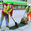 Lloyd Wetton, left, and Marcel Berlinquette, City of Prince George Truck Drivers  patch up some holes at Fourth and Queensway Monday morning. The craters desperately needed some TLC. Patching pavement, Tuesday, David Mah
