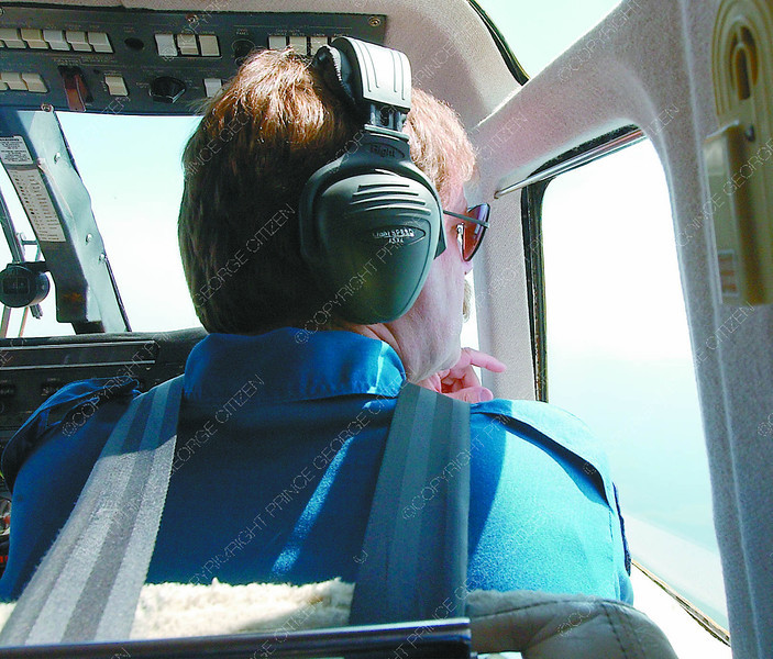 Air Attack Officer1/Thursday Brent Braaten-June 23/2004  Air Attack Officer Bart Vanderlinde looks out of the window of Bird Dog 51 looking for fire between Finger Lake and Tatuk Lake.