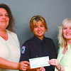 Canada Revenue SPCA/Wednesday Brent Braaten-June 22/2004  Lisa Tanasichuk, left and Sandy Stephens , right with Canada Revenue Agency present a cheque for $1,000 to Jeannine Woodhouse with the SPCA. Story to follow from Bernice