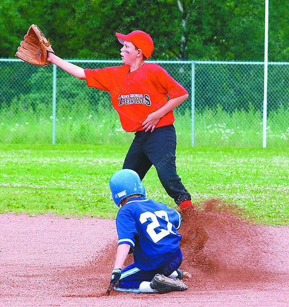 Second Base/Saturday Brent Braaten-July 2/2004  Timberwolves Chase Webb waits for the throw to second as Scott Unruh steals second. Runner was safe.