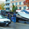 boat on queensway ave in  saturday dave milne oct 8 04 A boat is winched onto a wrecker flatdeck after it came off its trailer on Queensway near 17th Avenue Friday afternoon. The boat was struck by at least one surprised motorist.