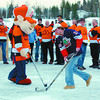 Collage Heights Ice Rink/Thursday Brent Braaten-Dec 15/2004  Homer the Home Depot Mascot and Brody Mott from the Prince george Spruce Kings play a little hockey with the Home Depot volunteers in the background during the official openinig of the new rink in collage Heights.