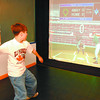 Citizen Sports Machine1/Friday Brent Braaten-May 5/2005  Reno Resendes, 12, trys the baseball game on the Citizen Sports Machine at The Exploration Place.