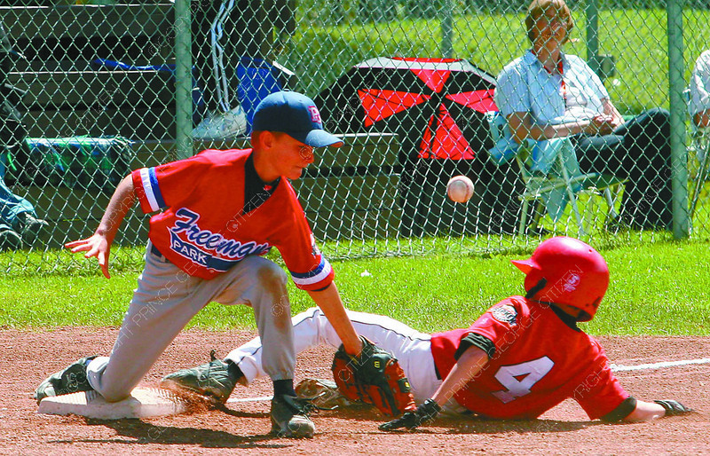 Jared Young of Capabilities 10 year olds is safe at third during Saturday's game against the LTN Contracting 9 year olds. Dexton DeWare just missed the catch. Third Base, 2005 Provincials, Tuesday, David Mah