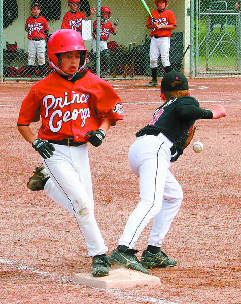 Riley Hawes beats the ball to first. Nanaimo's Lee Martin just missed the catch. 1st base, 20005 Provincials, Tuesday, David Mah