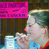 Eden Spas Cops for Cancer/Monday Brent Braaten-Sept 10/2005  Joshua Bennett paints his sisters face Elisha Bennett at the Eden Spas Saturday morning. They were there raising funds for the Cops For Cancer bike relay team and to celebrate the grand opening of Eden spas on Central. Thay also had a bbq to help raise funds.