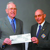 Knights Elder Citizen/Monday Brent Braaten-Oct 14/2005  Dr. Jack McKenzie, left , Chairman of the building committee of the Elder Citizens Recreation receives a cheque for $1,000  from John Hodgson, past Grand Knight of Knights of Columbus Council 8927. The money will be used to assist in the expansion of the Association Centre at 1692 Tenth Avenue.