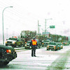domano traffic lights out in saturday dave milne jan 6 06 An RCMP officer directs traffic at Domano Blvd and 16W Friday after power was knocked out by an accident at Gauthier Road farther west.