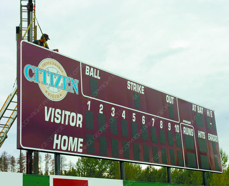 Citizen Field Score Board1/Thursday Brent Braaten-July 19/2006  Danny Andrews with JDK Sign Maintenance puts the last panel in place for the new scoreboard at Citizen Field.