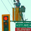 City of Prince George electrician Dusty Jackson hooks up a traffic camera at the 5th Avenue and Ospika intersection. The camera is more effective than the the underground loops ( sensors) at controlling traffic signals. traffic camera, Saturday, David Mah
