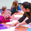 Five-year-old Ashley Wessner, left, and her sister Emily, 7, learned some technicla tips on drawing a cat from instructor Atieh at the Prince George Public Library. Eighteen children were in the class. Next classes are Oct. 21 and 28. drawing class, Monday, David Mah