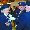 Poppy chairman Ron Walker places a poppy on the lapel of Alda Russman, Royal Canadian Legion 43 President at the grand opening of the 2006 Poppy Campaign held at the Pine Centre Friday morning. Past chairman Paul Domonkos stands by with poppies. Poppy Campaign, David Mah