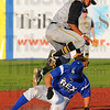 Tribune-Star/Jim Avelis In safe: Terre Haute Rex base runner Kyle Kempf is safe at second base as Hannibal shortstop Kris Goodman can't come up with the throw. Kempf went on to score the second run of the game for the Rex.