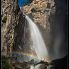 "Last year Willie, Will, and I got our first great moonbow photo while on top of the Upper Yosemite Falls trail. Thanks to some professors in Texas just about anyone can find out when the moon bows in Yosemite will occur. Trying to avoid the hoards of crowds at the Sentinal Bridge parking lot we decided to try to find a more unique moonbow and something different from last year. Willie and I had seen a number of timescape videos, most notably Steve Bumgardner's official video for the Yosemite Conservancy, in which moonbows were photographed at Cascade Falls. We knew we had to try this!   <br /> <br /> I spent a lot of time trying to figure out how to get to the proper location to shoot a moonbow at Cascade Falls. You need to get high enough and east enough to get around a jut in the rocks (you can see it here, where the water flows over, blocking the top of the falls) to get the proper angle to see the top of the falls, which has a really nice ""S"" curve to it. I used Google Earth and a number of other peoples images to get a vague idea of what we had to do. We found out that Steve traveled up from the bottom (along highway CA-140) but I thought you might be able to drop in from the top. When I arrived at Yosemite on Saturday I quickly ruled out the top-down approach. I hopped in the car, drove down to the bottom, and started on up. After an hour of completely sweating, super steep climbing, and searching high and low, I gave up on finding ""the perfect spot"". It was just too dangerous and without proper climbing gear I couldn't see any way to get to the spot that Steve took his photo.<br /> <br /> Dropping down a bit we found a nice area that gave a beautiful view of the main falls. In the afternoon weather the area was dry and pretty easy to get to. When Willie, Will, and I returned at night we were in for a shock -- the winds had picked up and were spraying mist all over the spot! Not wanting to be drenched for 2 hours we moved back to a safe distance where we go stay both dry and warm. There was a super moon this evening (the largest moon of the year) and we had hoped that its brightness would put on a great moonbow show, but we didn't know when exactly it would start. Every so often I would head back out to the falls to double check on the moonbow. Finally around 9:10pm we saw a faint bow and raced back to get our gear. It was super slipper on the rocks to our spots and we took extra caution not to slip and die. By now it felt like it was raining and we knew we had to be quick to get our shots.<br /> <br /> Proper planning was key to this. I brought along a rain-shield for my camera to keep my camera dry and attached the hood to the lens helped reduce a small amount of water hitting the lens. I also brought along 5 micro-fiber cloths because I knew I'd be wiping the lens dry quite often and they would get wet fast. I had just enough time to wipe the lens clean and then take a shot before the lens was completely covered. I went through 3 micro-fiber cloths in the 35 minutes that we were out there. Once we finally returned to dry land we realized how *completely* soaked we all were. It wasn't until the sun came up the next day that I was able to fully dry all my equipment! <br /> <br /> This years moon bows were much more faint than last years. We could just make out a silvery bow with our eyes, compared to last years full blast of color. Additionally, it wasn't until I looked at the LCD later that I realized we caught a small hint of a DOUBLE MOONBOW! <br /> <br /> Nikon D700 w/Nikkor 24-70mm f/2.8G ED AF-S:<br /> 42mm, f/4, 30 sec, ISO 640"